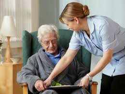 carer providing meal for older person at home